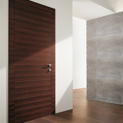 Flush Doors - Our flush doors feature the finest Italian veneers and finish of your choice together with modern stainless steel hardware to match your door beautifully. All our designs are simple yet elegant and with the most charming looks. Whether you are looking for a condo entry door or any other interior door at Dayoris we have a nice selection to complement  your interior decoration.