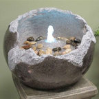 "13"" Fractured Stone Fountain - Although it looks like a fractured hollow stone, this fountain is actually made from a Lightweight fiberglass resin and contains a column of water lit by an underwater LED light. The pump and LED lighting are included."