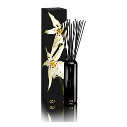 DayNa Decker Exotics Diffuser Refill 16oz-Nya - With its shadowy translucent glass vessel abloom with dark, slender reeds of sustainable wood and monogrammed in metallic gold, the deeply chic Exotic Essence Diffuser might be chosen for a striking transitional home accent even without the sweetly moody blend of aromatic floral oils it contains. The reeds pour soft, musky, intoxicating scents into your air for up to eight months; you need only invert the reeds once a week to turn your home into a multisensory experience of pleasure.