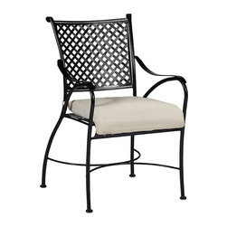 Frontgate - Paris Dining Arm Chair with Cushion - Crafted from hand forged wrought iron. Ultra UV resistant Ebony finish. Timeless lattice design. Electro-galvanized iron treatment provides weather resistance. From the Arc de Triomphe to the Eiffel Tower, the Paris Dining Arm Chair is a blend of boldness and stately sophistication. Paris strikes a curvaceous pose in classic wrought iron, boasting a transitional statement of timelessness. The seat and back pattern is formed by stamped steel that is electro-galvanized, then powder coated in an ultra UV resistant finish. . . . . Note: Due to the custom-made nature of the cushions, any fabric changes or cancellations made to the Paris Collection by Summer Classics must be made within 24 hours of ordering.