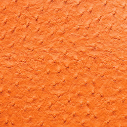 Emu Faux Leather / Vinyl Upholstery Fabric, Orange - This emu faux leather has a supple texture in orange, and is suitable for upholstery, cornice/headboards, and other decorative uses.