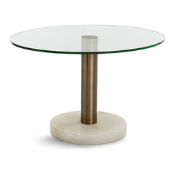 Landon Side Table - An oval top provides a more workable footprint to the Landon Side Table, a modish trio of glass, snowy marble, and steel crafted into an end table with transitional purity of line. Pair with the equally minimalist lines of an upright armless chair or low-slung futon, or use this table to enhance the utility of a seating space in your living room, library, or office.