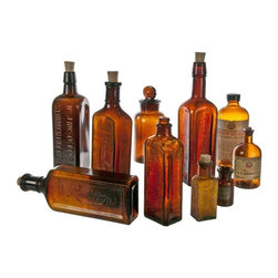 "Vintage Amber Display Bottles - Set of 10 - Store your homemade tinctures in these ten beautiful vintage amber glass bottles while you play pharmacist. OR just display this warmly-colored glass collection on a shelf or in a windowsill.  Assorted flavoring, liquor and apothecary containers with bakelite lids, glass and cork stoppers.  Sizes range from 3 1/4""h x 1 1/4"" diameter to 10""h x 2 1/2"" diameter."