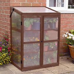 Gardman - Gardman Growhouse Cold Frame Greenhouse - 7652 - Shop for Greenhouses from Hayneedle.com! Additional FeaturesTwin-wall polycarbonate glazing keeps your plants warmHinged doors feature a latch bolt fasteningLocking stays on hinged lids allow for ventilationBoth cost and space-effective the Gardman Growhouse Cold Frame Greenhouse lets you enjoy fresh plants vegetables and flowers all year without taking up a lot of space or breaking your budget. Made with a solid rigid wooden frame this greenhouse has twin-wall polycarbonate glazing to keep your plants safe and warm. The greenhouse includes two slatted wooden shelves which provide ample space as well as drainage. The hinged doors have a latch bolt fastening while the locking stays on the hinged lids allow for ventilation.About GardmanOne of the fastest growing suppliers of decorative lawn garden and bird care products in the United States Gardman USA Inc. is a subsidiary of Gardman Ltd. the largest supplier of these products in the United Kingdom. Gardman has won the Garden Industry Manufacturers Association (GIMA) Supplier of the Year award for the last four years. Based in Kennesaw Ga. Gardman's goal is to provide high-quality well-designed functional products that offer consumers true value for their money.