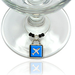 "Made on Terra - Plane Airplane Travel Flying Wine Glass Silver Charm - Your guests have arrived and the atmosphere is electric. A sip of wine here, a sip of a cocktail there and you find the conversation turning to the charming baubles you've placed on the glasses, something special you chose for each of your eclectic guests. They love them and appreciate your thoughtfulness. You love them for their uniqueness and that no one forgets which glass they were using.  Choose from Made on Terra's many designs for the best party ever. Ring is 1"" diameter; measures 2"" from top of ring to bottom of charm. Made of metal and plastic. Sold individually."
