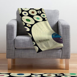 Record Hits Fleece Throw - You love music, this much is true. Why not incorporate this love into your décor? We suggest this fleece blanket, with its colorful pattern of records. Rock on!