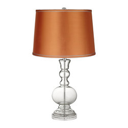 Color Plus - Clear Fillable - Satin Orange Shade Apothecary Table Lamp - This apothecary-style Clear Fillable designer glass table lamp features a stylish orange satin drum shade. The apothecary style glass table lamp offers a wonderful style accent. The clear glass base can be filled with your favorite collectible - from seashells to glass beads, the possibilities are endless! The design features a clear lucite base and is topped with a stylish orange satin drum shade. Lamp base U.S. Patent # 8,899,798.