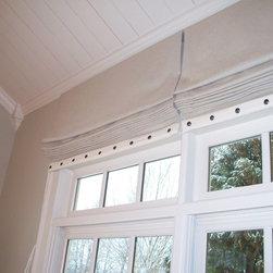 Window Treatments - Flat Linen roman shades with ivory band and  decorative nailhead trim by Encore Decor Atlanta