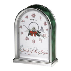 Howard Miller - Sounds of the Season Table Top Clock w Holida - Play a different Christmas melody with every passing hour. This table top clock will deck your halls! Sounds of the Season clock is arched and finished with a silver tone. The sides feature a green marble hue. Its white dial is embellished with painted greenery and red bow. This polished, sliver-finished arch table clock with green marble-tone sides plays a different Christmas melody on the hour, including: Jingle Bells; O Come All Ye Faithful; O Christmas Tree; Angels We Have Heard On High; O Little Town of Bethlehem; God Rest You Merry, Gentlemen; Hark! The Herald Angels Sing; Silent Night; Deck the Halls; The First Noel; Joy to the World; and We Wish You A Merry Christmas. A white dial features a decorative center of a traditional horn and seasonal greenery with a red bow, and soft green Arabic numerals with the names of the melodies printed in red at each hour location. The spade hour hand and diamond minute hand are silver-finished. Full felt bottom protects your tabletop. Quartz movement includes the battery. 5 1/2 in. W x 2 1/2 in D x 7 1/2 in. H