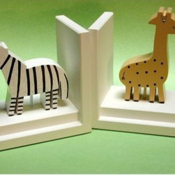 Khaki Giraffe/Zebra Bookends with White Base - Your little boy will love gathering and storing his books between his black striped zebra and polka dotted khaki giraffe bookends with white base. The seemingly wagging tails warm eyes and smiles make these wild guys accessible. These bookends have been handcrafted and hand-painted.About OneWorld KidsOneWorld was started by Jay Brandt and Pam Gold more than a decade ago. Originally unique products were imported from Indonesia but as OneWorld grew they became the manufacturer of their entire product line. Based in Salt Lake City Utah OneWorld has raised the bar in kid's decor with thousands of products designed to accessorize and complete a child's room. At OneWorldKids accessorizing is all about style color and fun.