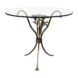 Pre-owned 1960s Flower Motif Wrought Iron Table - This 1960s hand made wrought iron table with flower motif screams flower power!!  It comes complete with a round glass top and will be the perfect accent to a Hollywood Regency styled room.