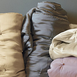 Eileen Fisher Seasonless Silk Comforter - This hand-tufted comforter is pure silk, from its sensuous charmeuse exterior to its light-as-air silk fill. Warm in winter and cool in summer, it provides temperature-regulating comfort.