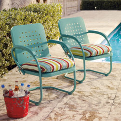 Retro Outdoor Furniture Collection - I'm a sucker for retro patio furniture. These chairs are part of a larger set so you can coordinate an entire outdoor space or just buy a pair of chairs for a conversation nook. They come in multiple fun colors.