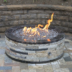 """35"""" round fire pit - This is a 35"""" granite fire pit that is around 12.5 inches high.  It is made from solid granite that is recycled.  It is an Easy Do-It Yourself kit.  It's environmentally friendly, has the quality of stone and is simply stunning!"""