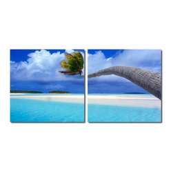 """Wholesale Interiors - Windswept Palm Mounted Photography Print Diptych - Stretching sideways over the sea, the palm tree in this photograph is framed by crystal clear waters and soft, fine sand. Made in China with MDF wood frames, this two-piece modern wall art set features an image split in half and printed on two waterproof vinyl canvases. The Windswept Palm Diptych is made in China and is fully assembled. Hardware for hanging on the wall of your choice is not supplied. To clean, wipe with a dry cloth. Product dimension: 19.68""""W x 1""""D x 19.68""""H."""
