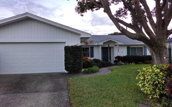 Grey New Roof White Stucco And Painted Brick Of 1968 Ranch In Florida