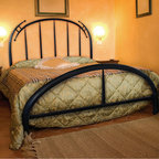 Pinnacle Bed - This fun, funky, hand forged wrought iron bed looks like it came straight from Willy Wonka. Perfect for bedrooms decorated with a little edge. Hand crafted with an industrial flair designed to accentuate the process of construction and create a clean, rugged and primitive appearance. Some customization is available for an up-charge in price.