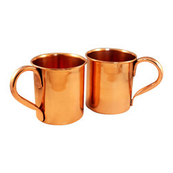 Custom Copper Mugs, LLC - Pure Copper Mugs - set of 2 - Our Moscow Mule Mugs are constructed of 100% pure copper. We apply a food-safe lacquer that resists tarnishing for lasting beauty and luster. The mug of choice when serving the infamous Moscow Mule--a cocktail made from a blend of vodka, ginger beer, and lime juice. The copper mug enhances the flavor and keeps the drink colder, longer.