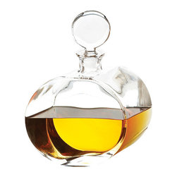 Round Offset Clear Glass Decanter - Welcome home. You've just closed the biggest deal of your career. You deserve a reward. You look to your dining room bar and this Round Offset Clear Glass Decanter looks back at you, inviting you to treat yourself to a slow, sweet sip of whiskey. Its traditionally-inspired design is as classy as you feel, and you can wet your whistle knowing we've crafted this beauty from natural materials that don't strain the environment. Treat yourself for that, too.