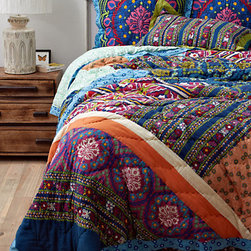 Wildfield Quilt - Patchwork goes global with this busy but still beautiful quilt. I can't pick a favorite color; I love them all! But be careful: such a wild pattern means you should tone down the rest of the room.