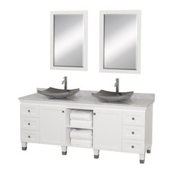 Wyndham Collection - 72 in. Eco-Friendly Bathroom Vanity in White Finish - Includes natural stone counter, backsplash, two vessel sinks and matching mirror. Faucets not included. Engineered to prevent warping and last a lifetime. Highly water-resistant low V.O.C. finish. 12 stage wood preparation, sanding, painting and finishing process. Floor standing vanity. Deep doweled drawers. Fully extending bottom mount drawer slides. Soft close concealed door hinges. Single hole faucet mount. Plenty of storage space. Brushed steel leg accents. Metal hardware with brushed chrome finish. Two doors and six drawers. White Carrera marble top. Black granite sinks. Made from zero emissions solid oak hardwood. Vanity: 72 in. W x 22.5 in. D x 36 in. H. Mirror: 24.25 in. W x 36.25 in. H. Handling InstructionsCutting edge, unique transitional styling. A bridge between traditional and modern design, and part of the Wyndham Collection Designer Series by Christopher Grubb, the Premiere Single Vanity is at home in almost every bathroom decor, resulting in a timeless piece of bathroom furniture.