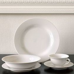 PB White Cup & Saucer, Set of 4 - Made of high-quality porcelain, our PB White Dinnerware has the durability to stand up to daily use. Ideal for casual dining or entertaining, the dinnerware has an understated simplicity that mixes well with table linens of your choosing.Made of high-fired, white-glazed porcelain.16-piece set includes 4 dinner plates, 4 salad plates, 4 cereal bowls and 4 mugs.20-piece set includes 4 dinner plates, 4 salad plates, 4 soup bowls, 4 cups and 4 saucers.Select items are Internet Only.