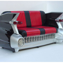 Sunbelt Marketing Group - 1959 Cadillac Couch in Red - Kick back and relax in style with this AWESOME car couch. It's made from high-gloss fiberglass and top-quality leather, with working lights and incredible attention to detail. Built to last with a sturdy frame construction. It's perfect for your Man Cave, Game Room, Office or anywhere you want to show love for your favorite vehicle! Due to size and weight, this item ships via truck freight. Officially licensed GM product. Measures approximately 6 x 4 x 4 feet.