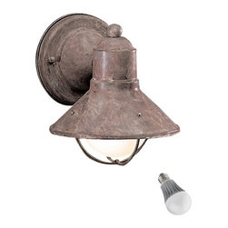 Kichler Lighting - Kichler 7-1/2-Inch Nautical Outdoor Wall Light with LED Bulb - 9021OB  8W LED - This sleek conical outdoor wall light features a nautical design and an attractive olde brick finish. Enhancing the marine look is a cage-like structure, which also protects the bulb. Included is an energy savings LED bulb which lasts up to last 6 times longer than compact fluorescent bulbs and 35 times longer than an incandescent. Features a medium base with white diffuser and vented heat sink. Takes (1) 9.5-watt LED A19 bulb(s). Bulb(s) included. Wet location rated.