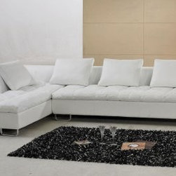 White Leather Modern Sectional Sofa with Metal Legs - I think the tufted seating on this simple white couch makes it unique. I like the texture.