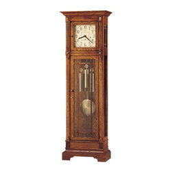 Howard Miller - Howard Miller - Greene Floor Clock - Time whispers from stroke to stroke with this handcrafted, oak floor clock featuring Kieninger Chime and silent option feature, a mesmerizing piece that captures the exquisite beauty of classic grandfather clock. * In the tradition of the Arts and Crafts Guilds, famous for their handcrafted, simple, honest, and pure design. . The cream dial continues the simplicity with dark brown corner accents, numerals, and hands. Decorative wooden moldings nicely frame the dial. . Wooden, reeded grilles accent the front lower door. . Circular brushed brass weights and pendulum are antiqued, along with the front locking door accessories. . Cable-driven, Westminster chime Kieninger movement with chime silence option. . Finished in Heritage Oak on select hardwoods and veneers. . You will receive a free heirloom plate, engraved with name and date, by returning the enclosed request card to Howard Miller. . Locking door for added security. . 79 1/2 in. (202 cm) H x 25 1/2 in. (65 cm) W x 14 in. (36 cm) D. Manufacturer's 2 Year Warranty