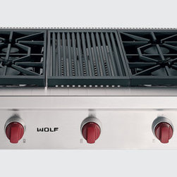 "Wolf 36"" Sealed Burner Rangetop - There's good reason why professional chefs choose gas cooking; control. The patented, dual-stacked sealed gas burners of our Sealed Burner Rangetop take control to a new level. Two levels, really. The upper-tier ports deliver maximum heat transfer at higher settings; the lower-tier continuous flame is capable of handling the subtleties of simmering and melting."