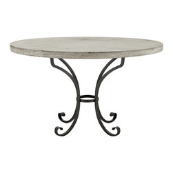 "Marcella Round Concrete Dining Table with Iron Base - With a tabletop made of high-grade mineral composition concrete and a base of solid wrought iron, Marcella is ideal for al fresco dining year round. The tabletop is carefully poured and cut to spec into a 48"" round and 42"" w x 48"" l rectangle, and then finished by hand and polished until a smooth, glass-like surface is achieved. The table's base is made of wrought iron—our artisans give it some subtle curves and distressing. Year after year, the finish on both pieces will develop and only get more beautiful."
