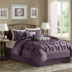 Madison Park - Madison Park Laurel 7 Piece Comforter Set - This beautifully tufted bed is from the Laurel bedding collection. Its deep plum coloring makes this set create a statement in your bedroom. The collection is made from 100% polyester polyoni and has pieced fabric sewn together to give this set dimension. It is finished with a smooth edge of fabric that creates a beautiful border around this comforter. Comforter/Sham: 100% polyester polyoni, pieced with pleats, 100% brushed polyester reverse, 270g/m2 polyester filling Bedskirt: 100% polyester fabric drop, polyester platform Pillows: 100% polyester polyoni cover with polyester fill