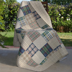 None - Oxford Quilted Throw - The Oxford quilted throw,with a variety of colorful plaid squares,bordered within a coordinating ground,reverses to an all-over neutral plaid. This quilt contains a variety of colors popular in the home or dorm.