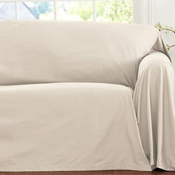 """Twill Dropcloth Loose-Fit Slipcover, Sofa, Cream - The casual style of a Cape Cod summer house inspired our fresh take on the slipcover. Made of thick, soft cotton twill, the drop cloth offers an easy way to transform your sofa and create a relaxed, untailored look. Simply drape it over the sofa, and it falls into place without the need for fine-tuning. Protects furniture from the rigors of everyday family life. Loosely flowing fabric along the bottom has a subtle pooling effect. Available for furniture with square or T-shaped cushions. Our slipcovers are designed to fit a wide variety of furniture styles. As a result, there may be more fabric than you need. Easy to care for and simple to store. To order fabric swatches free of charge, click """"request swatches"""" below. Catalog / Internet Only. Imported."""