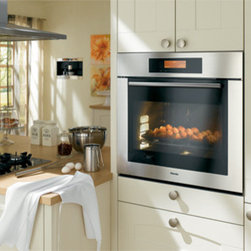 "MasterChef 30"" Single Oven - Miele's 30"" MasterChef Single Oven is equipped with everything you'd ever need to become a (you guessed it) Master Chef. Touch control pad, AutoRoast features, a food-driven menu system, automatic temperature settings, two zone infrared broiling, and a ThermoClean system are but a taste of the amazing features that come with this professional-grade oven."