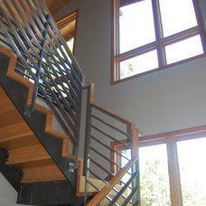 Contemporary Staircase by Moderna Homes, Inc.