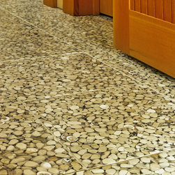 New England Cottage-Style Floors - Fun, Durable and a Nice twist on the popular beach pebbles floor, these are 12x12 tiles made of actual shells and resin, which means far less grout to worry out. A natural fit in any island setting. Art of Tile and Stone !!!