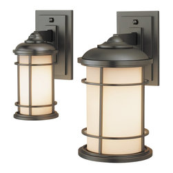 Murray Feiss - Murray Feiss Lighthouse Transitional Outdoor Wall Sconce X-BB1022LO - This transitional outdoor wall sconce brings the calm and serenity of the water right to your home. This sconce takes its inspiration from traditional lighthouse design and is sure to light your way home as well. The opal etched glass creates a warm glow that is framed by a brass cage finished in burnished bronze.