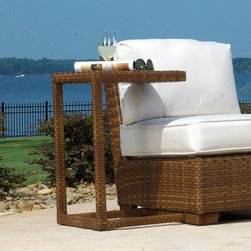 Panama Jack - Panama Jack St. Barths End Table - Brown Pine with Viro Fiber - PJO-3001-BRN-ET - Shop for Tables from Hayneedle.com! The Panama Jack St. Barths End Table - Brown Pine with Viro Wicker makes a welcome addition to any patio furniture setting. The table is built from an extruded aluminum frame with an exclusive thick woven Viro wicker fiber. It can fit into a variety of setups and it easily holds drinks and books to complement an outdoor relaxation session. The wicker is both weather- and UV-resistant for durable outdoor use and the aluminum will never rust. Dimensions: 20L x 20W x 20H inches.About Hospitality RattanHospitality Rattan has been a leading manufacturer and distributor of contract quality rattan wicker and bamboo furnishings since 2000. The company's product lines have become dominant in the Casual Rattan Wicker and Outdoor Markets because of their quality construction variety and attractive design. Designed for buyers who appreciate upscale furniture with a tropical feel Hospitality Rattan offers a range of indoor and outdoor collections featuring all-aluminum frames woven with Viro or Rehau synthetic wicker fiber that will not fade or crack when subjected to the elements. Hospitality Rattan furniture is manufactured to hospitality specifications and quality standards which exceed the standards for residential use.Hospitality Rattan's Environmental CommitmentHospitality Rattan is continually looking for ways to limit their impact on the environment and is always trying to use the most environmentally friendly manufacturing techniques and materials possible. The company manufactures the highest quality furniture following sound and responsible environmental policies with minimal impact on natural resources. Hospitality Rattan is also committed to achieving environmental best practices throughout its activity whenever this is practical and takes responsibility for the development and implementation of environmental best practices throughout a