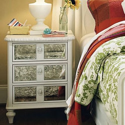 smartstuff Bellamy Vintage 3 Drawer Nightstand - Daisy White - With a glass of water, a bedtime book, and the smartstuff Bellamy Vintage 3 Drawer Nightstand - Daisy White, your little girl will have everything she needs to drift off into sweet dreams. This beautiful nightstand has plenty of room for storing a journal, book, or whatever miscellanies your daughter needs close at hand. And you'll rest easy, too, knowing that this quality piece can last from infancy to adulthood. Fun extras, such as the included set of inspirational coasters, endear this nightstand to little girls, while more mature young ladies will appreciate the classic, tasteful style. And the smooth metal-on-metal guides, thick drawer walls, screwed-in back panel, and English dovetail construction showcase high-quality craftsmanship sure to keep this nightstand looking beautiful year after year.The Bellamy Collection is full of elegant details that offer your little girl's room a timeless sophistication she'll appreciate even as she becomes a young lady and beyond. The antiquated finish provides a soft feel just right for delicate sensibilities, while the solid high-quality construction mirrors the strength of your daughter's developing confidence and character. Attractive details such as egg-and-dart molding and turned bun feet exhibit a balance between beauty and utility.About Universal Furniture InternationalRecognized as a leader in exceptionally crafted home furnishings, including bedroom and dining room items, entertainment centers, and more, Universal strives to make items that are styled to endure but always remain fresh. They make it a goal to include features that fit the way their customers live today, and to find prices that put high-quality products within reach. These are the principles that guide the work at Universal, essential elements of good, affordable, and smart design.