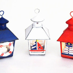 Nautical Lantern Tea Light - I know these darling metal tea light holders are meant for a kids' party, but what can I say?They got my inner child excited.