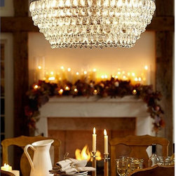 Clarissa Chandelier - Hundreds of glass droplets form a shimmering cascade on this chandelier. Crystals in alternating teardrop and raindrop shapes, with a faceted globe at the bottom, are so densely strung they completely cover the metal framework.