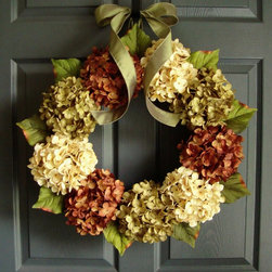 Autumn Hydrangea Porch Wreath by HomeHearthGarden - The summer and fall wreath design captures the earthy elements of the seasons. This wreath features the finest quality of artificial green hydrangeas, cocoa brown hydrangeas, and soft cream hydrangeas and complemented with a satin fabric parsley-green bow on a natural grapevine wreath base. Green leafs accent the perimeter of the wreath with just a subtle touch of the changing of the seasons.