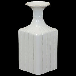 "Benzara - Elegant and Sophistic Design Square Shaped Ceramic Flower Pot in White - Unique and contemporary, the Elegant and Sophistic Design Square Shaped Ceramic Flower Pot in White will brighten your interiors and accentuate your decorations with its elegant looks and design. This ceramic vase features an unconventional cube shaped body with a slim neck and a wide mouth. The vase is made from ceramic and sports a glorious white shade that will elevate your home decor and add tone and depth to your furnishings. The dimensions of the Elegant and Sophistic Design Square Shaped Ceramic Flower Pot in White are 5""x5""x11.5""H. Ceramic; White; 5""x5""x11.5""H; Dimensions: 5""L x 5""W x 12""H"