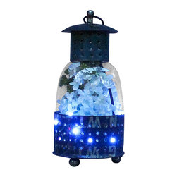 The Firefly Garden - The Firefly Lantern - Illuminated Floral Design, Small - Navy - This unique lantern is made from a reclaimed steel drum, filled with Lilac and illuminated underneath giving the appearance of fireflies in the summer evening. This rustic piece makes a charming home accent that's perfect for an outdoor gathering with friends and family. This arrangement comes with a lithium coin 3V battery.