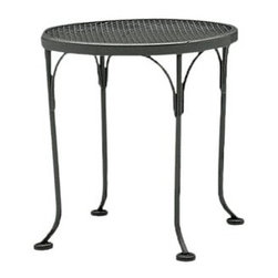 Woodard - Woodard Mesh Wrought Iron 17 Round End Table - The name Woodard Furniture has been synonymous with fine outdoor and patio furniture since the 1930s continuing the company�s furniture craftsmanship dating back over 140 years. Woodard began producing hand-made wrought iron furniture which led the company into cast and tubular aluminum furniture production over the years.� Most recently Woodard patio furniture launched its entry into the all-weather wicker furniture market with All Seasons which is expertly crafted and woven using synthetic wicker supported by an aluminum frame.� The company is widely known for durable beautiful designs that provide attractive and comfortable outdoor living environments.� Its hand-crafted technique used to create the intricate design patterns on its wrought iron furniture have been handed down from generation to generation -- a hallmark of quality unmatched in the furniture industry today. With deep seating slings and metal seating options in a variety of styles Woodard Furniture offers the designs you want with the quality you expect.  Woodard aluminum furniture is distinguished by the purest aluminum used in the manufacturing process resulting in an extremely strong durable product which still can be formed into flowing shapes and forms.� The company prides itself on the fusion of durability and beauty in its aluminum furniture offerings. Finishes on Woodard outdoor furniture items are attuned to traditional and modern design sensibilities. Nineteen standard frame finishes and nineteen premium finishes combined with more than 150 fabric options give consumers countless options to design their own dream outdoor space. Woodard is also the exclusive manufacturer of outdoor furnishings designed by Joe Ruggiero home decor TV personality.� The Ruggiero line includes wrought iron aluminum and all weather wicker designs possessing a modern aesthetic and fashion-forward styling inspired by traditional Woodard patio furniture designs. Rounding out Woodard�s offerings is a line of distinctive umbrellas umbrella bases and outdoor accessories.� These offerings are an integral part of creating a complete outdoor living environment and include outdoor lighting and wall mounted or free standing architectural elements � all made with Woodard�s unstinting attention to detail and all weather durability. Woodard outdoor furniture is an American company headquartered in Coppell Texas with a manufacturing facility in Owosso Michigan.� Its brands are known under the names of Woodard Woodard Landgrave and Woodard Lyon Shaw. With a variety of collections Woodard produces a wide array of collections that will be sure to suit any taste ranging from traditional to contemporary and add comfort and style to any outdoor living space. With designs materials and construction that far surpass the industry standards Woodard Patio Furniture creates beauty and durability that is unparalleled.  Features include Made of extremely durable wrought iron material Hand formed by skilled craftsmen to insure the strongest furniture in the industry Offered in wide selection of powder coated finishes manufactured to prevent rust Round slick shape Metal table top Commercial Grade.