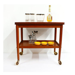 Randers Vintage Bar Cart - Vintage teak and handsome lines make this Danish Modern bar cart a stylish must-have. If you're the entertaining type, you'll love its super-practical features, too, like an extending surface for extra space and casters to take the party with you wherever you go. Load it up with bottles and glasses, and let the party begin.