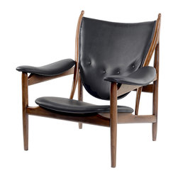 NyeKoncept - Jet Black Arne Chair - Inspired by Finn Juhl's mid century icon Chieftain Chair, the Arne Chair explores the ingenious idea of separating the seat and the back from the frame. This groundbreaking design, which features primitive weaponry shapes, had a great influence on the future Danish craftsmanship.