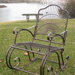 International Caravan - International Caravan Sun Ray Iron Rocker - Once you see this traditional iron rocker,you will want to spend every day sitting outside. The bold sun pattern on the back of the chair adds a decorative touch,and the hammered copper finish will mesh with any other outdoor furniture you have.
